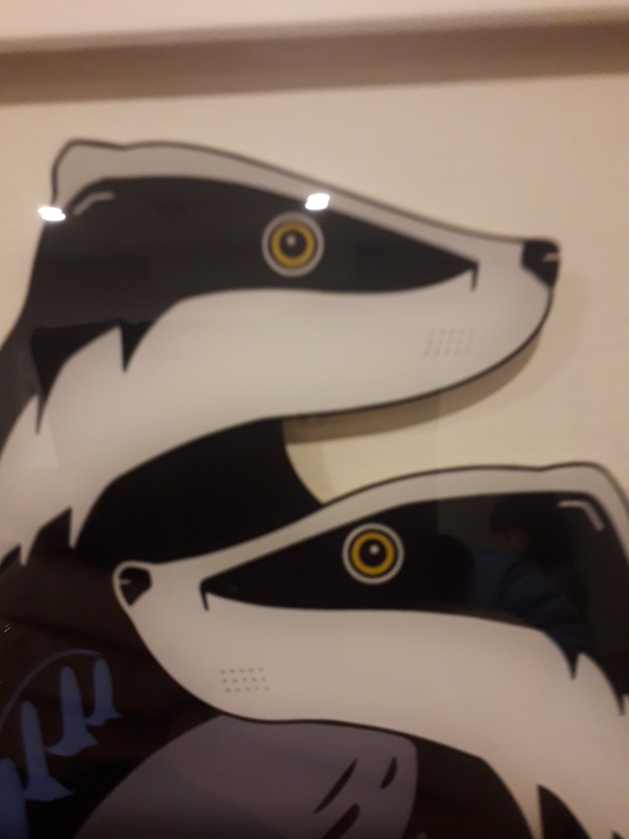 Glass Paintings of a robin and of badgers from Black Hen Designs
